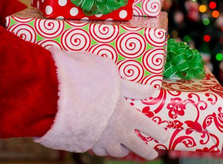Santa hands with presents