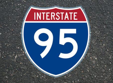 I-95 sign on asphalt background