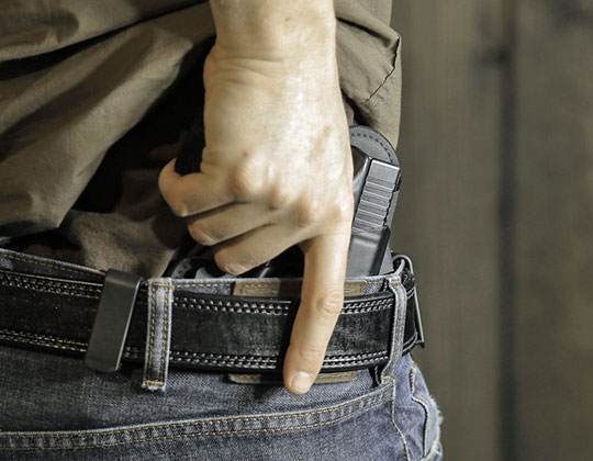 handgun in holster, belt concealed carry