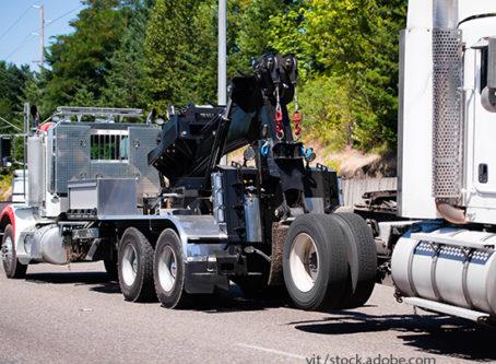 Tow truck hauls a semi tractor