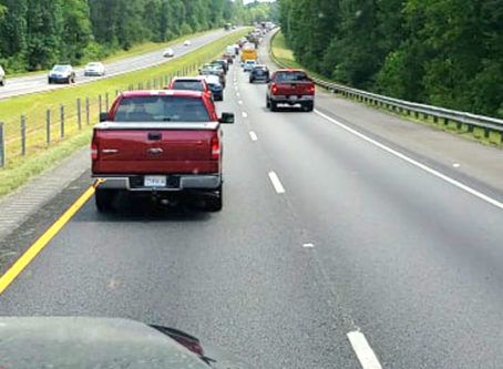 Traffic backs up as they mow the grass in Alabama