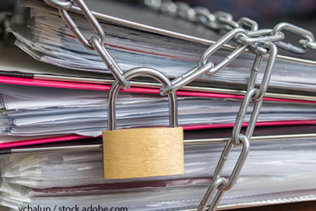 Chain, padlock on binder folders with papers