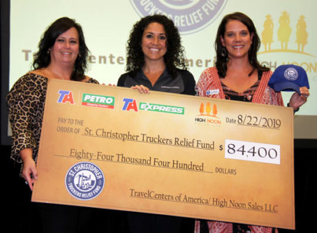 TravelCenters of America makes an $84,400 donation to the St. Christopher Fund during a ceremony on Thursday at the Great American Trucking Show in Dallas.