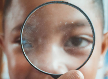 Child inspection through magnifying glass