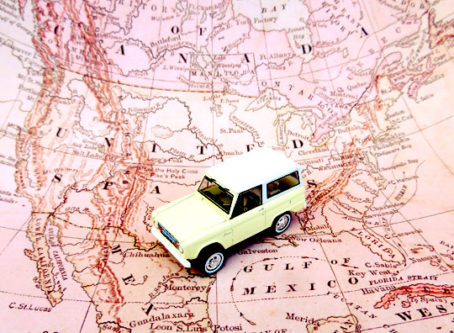 Symbol for NAFTA: map of North America, toy SUV
