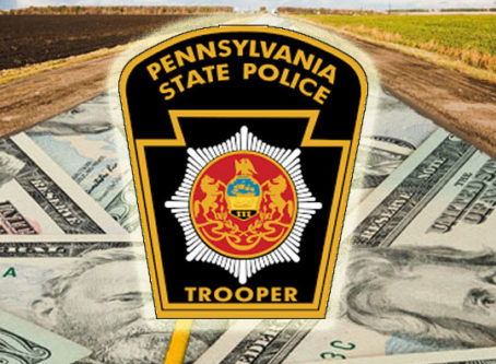 Pennsylvania State Police patch, money and road.
