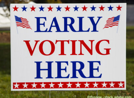 Early Voting Here sign. Take advantage of early voting, absentee voting and mail voting opportunities to make your voice heard.