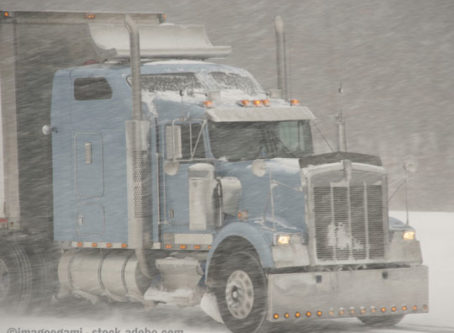 Truck in winter, snow-free vehicle mandate