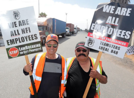 Port workers on strike for being misclassified, which AB addresses