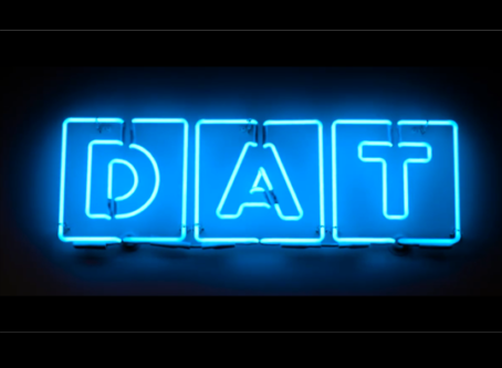 DAT Solutions logo in neon