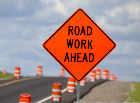Road Work Ahead sign, true of a road funding deal can be worked out