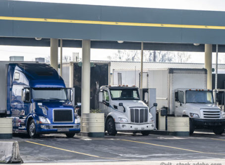 Semi trucks at truck stop fuel pumps