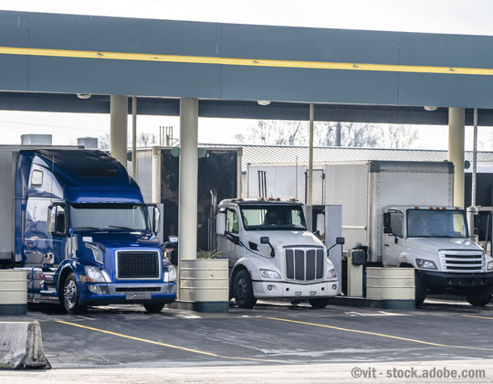 diesel price Semi trucks at truck stop fuel pumps