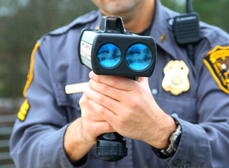 Officer holding speed radar device