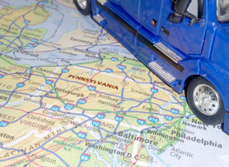 Map, toy semi truck, PA transportation task force offers funding solutions