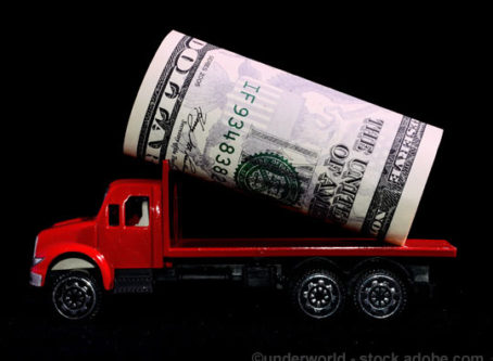 Tronsportation spending represented by toy truck with U.S. Money in the flatbed