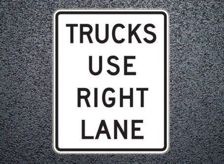 Trucks use right lane sign