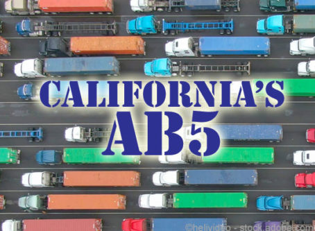 California's AB5 independent contractor law over image of lines of trucks a a California port