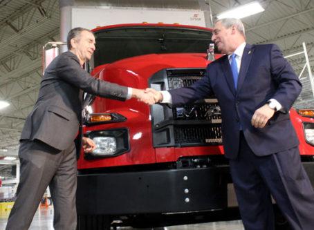 Gov. Ralph Northam, Mack Trucks President Martin Weissburg, new MD Series Mack truck