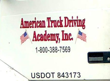 American Truck Driving Academy on side of truck