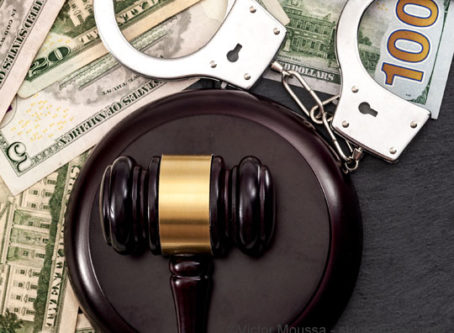 court sentencing, gavel, handcuffs and money