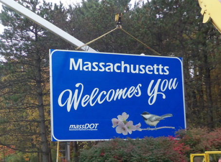 Massachusetts Welcomes You sign going up CDL