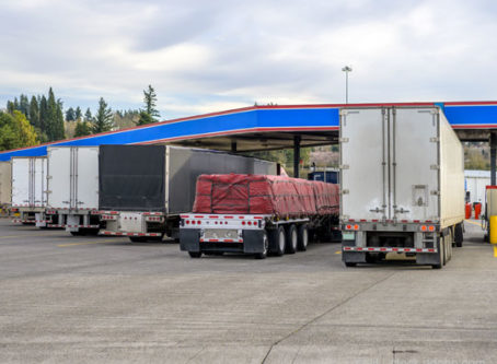 Semis at diesel fuel pumps at truck stop