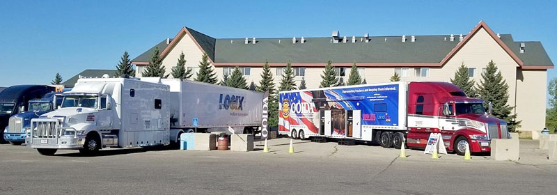 OOIDA's tour trailer, The Spirit, next to a truck with a huge sleeper
