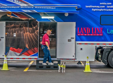 OOIDA's tour trailer with skipper Jon Osburn and his canine co-pilot, Sassi