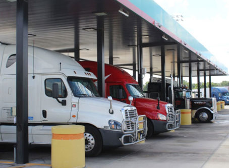 Diesel prices, tractor-trailers at fuel pumps