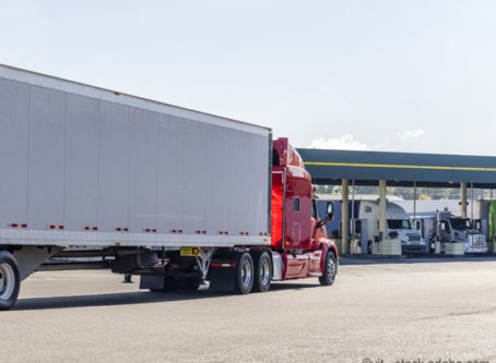 Diesel pumps, tractor-trailers at truck stop