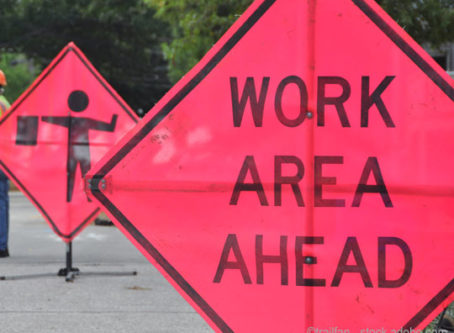 Road work ahead sign, road and bridge repair, infrastructure upgrade