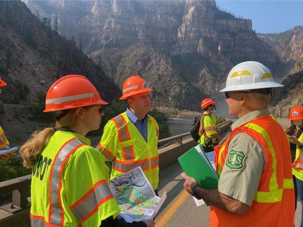Polis/Lew surveying Glenwood Canyon damage