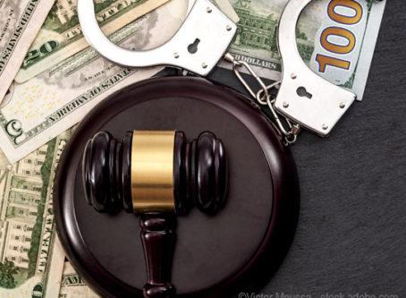 Judge's gavel, U.S., money, handcuffs