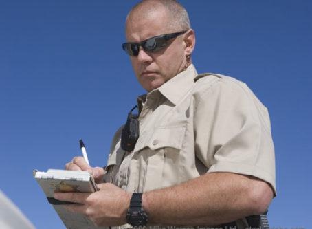 Officer writing traffic ticket